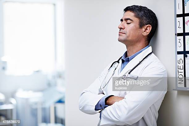 taking a moment to himself - handsome doctors stock pictures, royalty-free photos & images