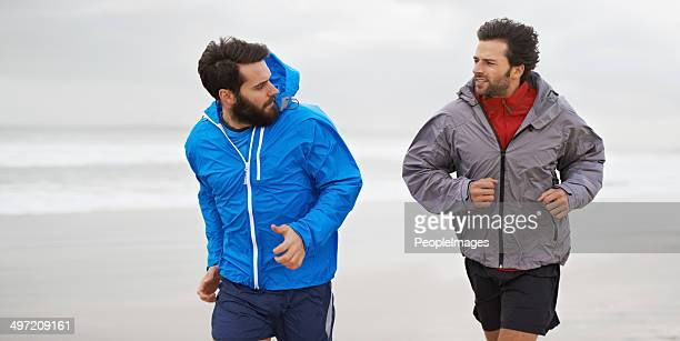 taking a morning run on the beach - muscle men at beach stock photos and pictures