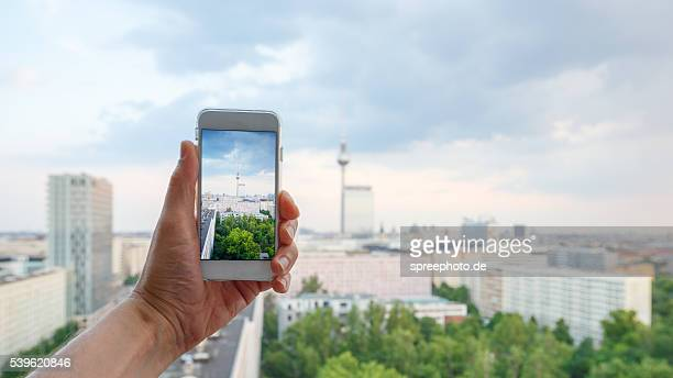 Taking a photo of a Berlin Skyline on a smart phone.