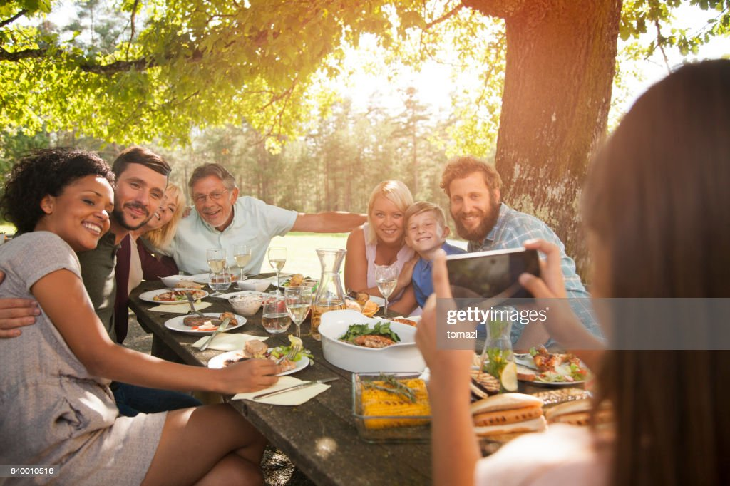 Taking a photo of a big family. : Stock Photo