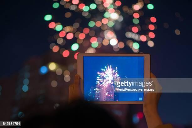 Taking a photo of firework display