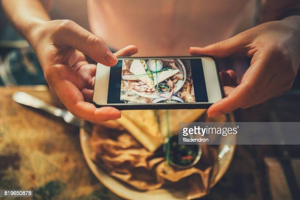 taking a photo of food - tortilla flatbread stock photos and pictures