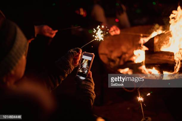 taking a photo of sparklers - fire pit stock pictures, royalty-free photos & images