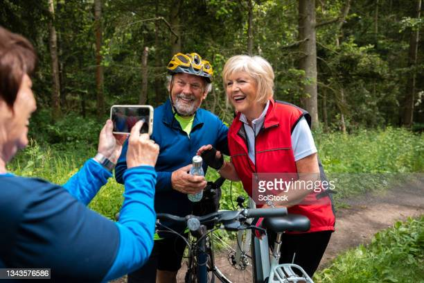 taking a photo on a bike ride - morpeth stock pictures, royalty-free photos & images