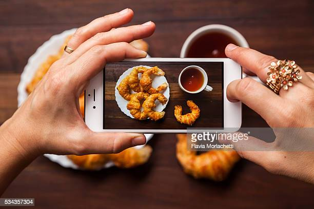 Taking a photograph with cell phone of breakfast