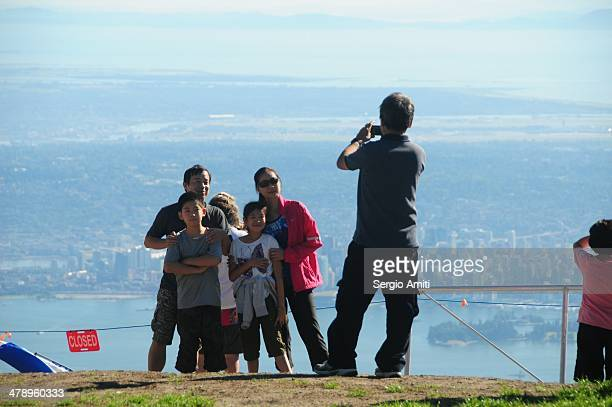Taking a picture on Grouse mountain with Vancouver in the background