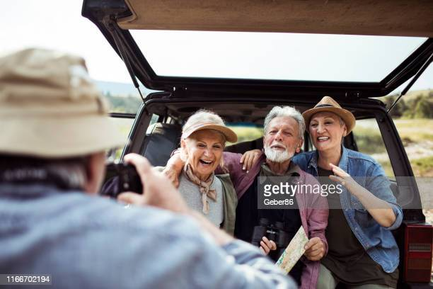 taking a picture - four people in car stock pictures, royalty-free photos & images