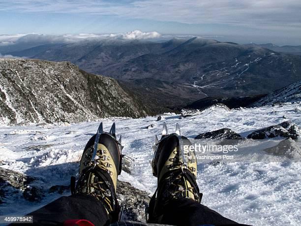 HAMPSHIRE DECEMBER 2 2013 Taking a rest after climbing Tuckerman's Ravine on Mount Washington Tuckerman's Ravine is a historic destination for...