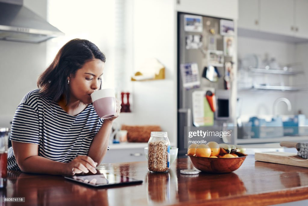 Taking a scroll through all her networks : Stock Photo