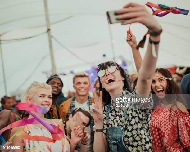 taking a selfie at a music festival - music festival stock pictures, royalty-free photos & images