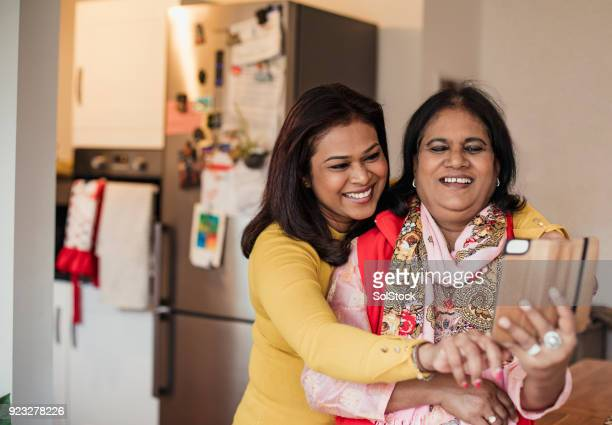 taking a selfie in the kitchen - bangladesh mother stock pictures, royalty-free photos & images