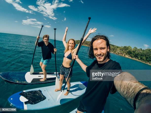 taking a selfie on paddle boards - paddleboard stock pictures, royalty-free photos & images