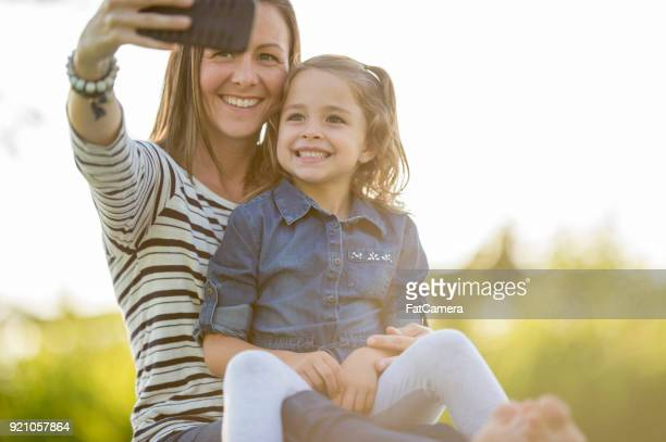 taking a selfie outdoors - nice girls pic stock photos and pictures