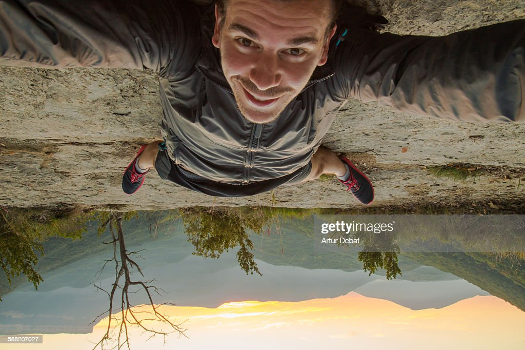 Taking a selfie up side down on the nature : Stock Photo