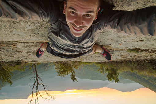 Taking a selfie up side down on the nature - gettyimageskorea