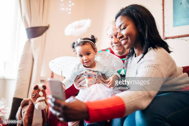 Taking a Selfie with her Family on Christmas Morning