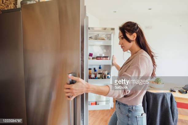 taking a study break - refrigerator stock pictures, royalty-free photos & images