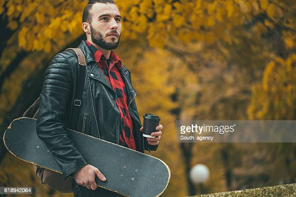 taking a walk in a park - leather shirt stock pictures, royalty-free photos & images