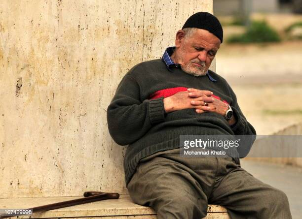 CONTENT] Taking advantage of the nice weather on a January day an old man dozed off while sitting under the Statue of Martyrs in the heart of Beirut...