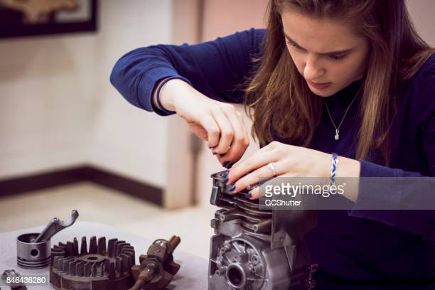 taking apart an engine for fun and learning - american influence stock photos and pictures