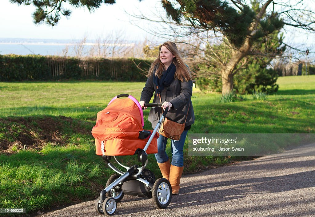 Taking baby for a walk. : Stock Photo