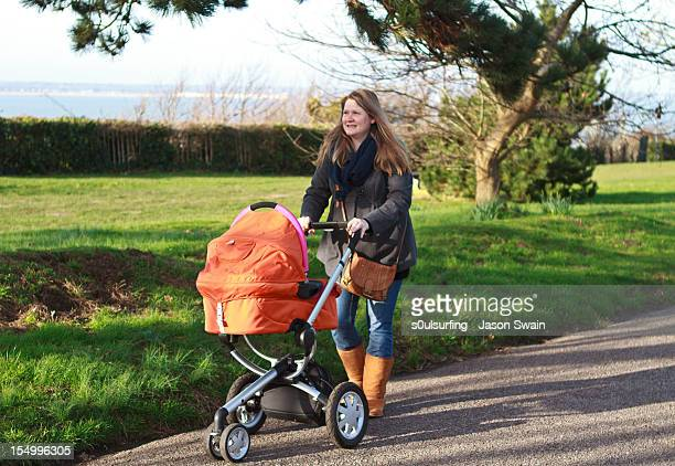 taking baby for a walk. - s0ulsurfing stock pictures, royalty-free photos & images