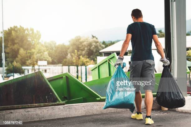 taking care of better tomorrow - waste recycling - garbage dump stock pictures, royalty-free photos & images