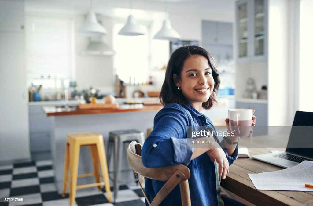 Taking care of business with a cuppa tea : Stock Photo