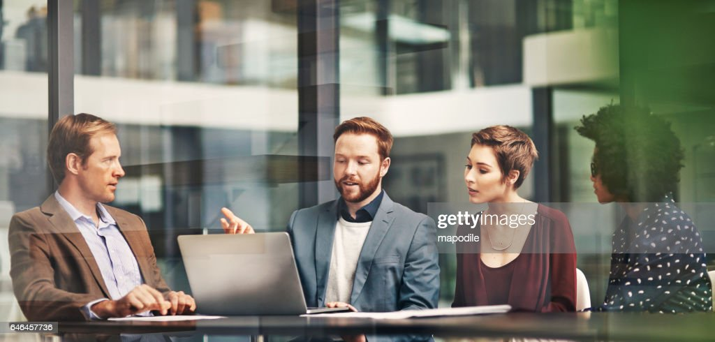 Taking care of business with teamwork and technology : Stock Photo