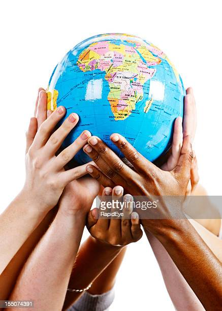 Taking care of our world; many hands support geographical globe
