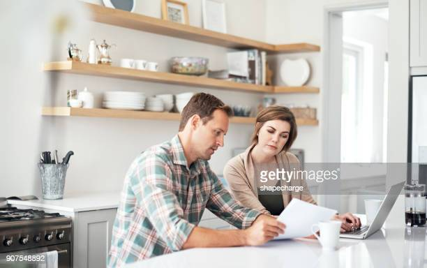 taking care of their household finances - home finances stock photos and pictures