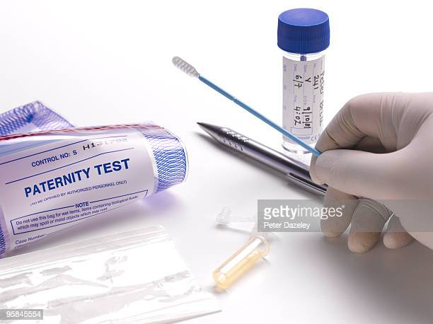 Taking DNA swab for paternity test.
