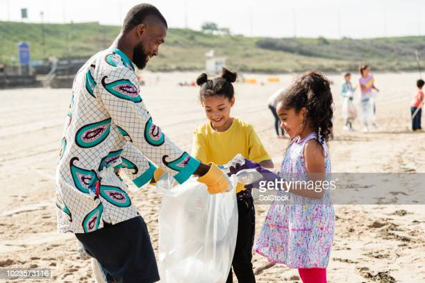 taking environmental issues in their own hands - dashiki stock photos and pictures