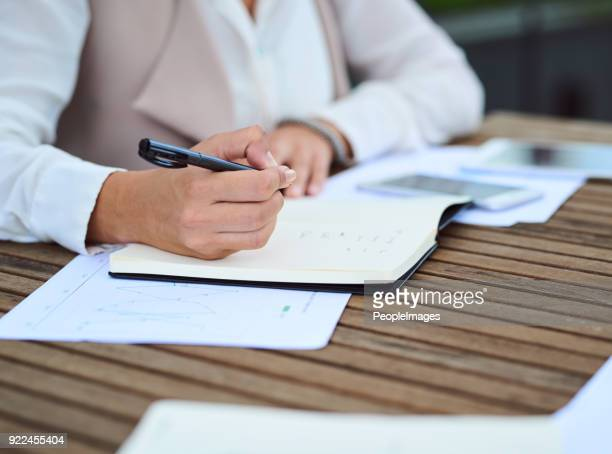 taking extensive notes - diary stock pictures, royalty-free photos & images