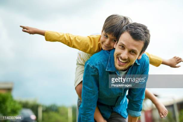 taking flight with my little man - shoulder stock pictures, royalty-free photos & images