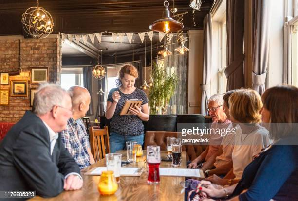 taking food orders in an english pub - british culture stock pictures, royalty-free photos & images
