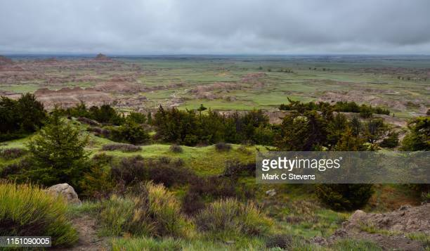 taking in a wide eye view to badlands while walking the cliff shelf nature trail - great plains stock pictures, royalty-free photos & images