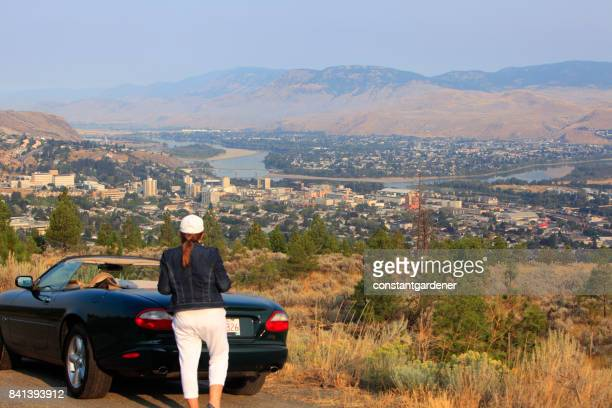 taking in the early morning view high above downtown kamloops - kamloops stock pictures, royalty-free photos & images
