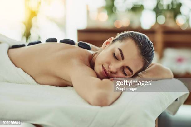 taking it right to the muscles with heat - massage stock photos and pictures