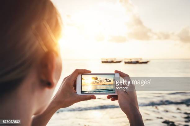 taking memories from zanzibar - beach photos stock pictures, royalty-free photos & images