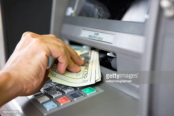 Taking money from ATM machine