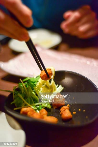 taking nankotsu with chopsticks - sapporo stock pictures, royalty-free photos & images
