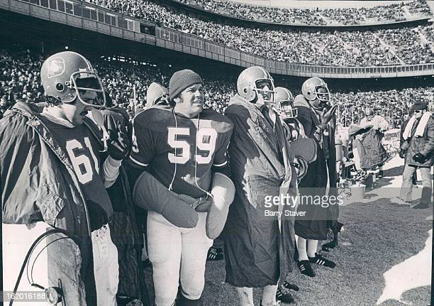 DEC 10 1972 DEC 11 1975 Taking No Chances Of Losing One Of His Mittens Center Larry Kaminski of the Denver Broncos uses a pair of special mittens...