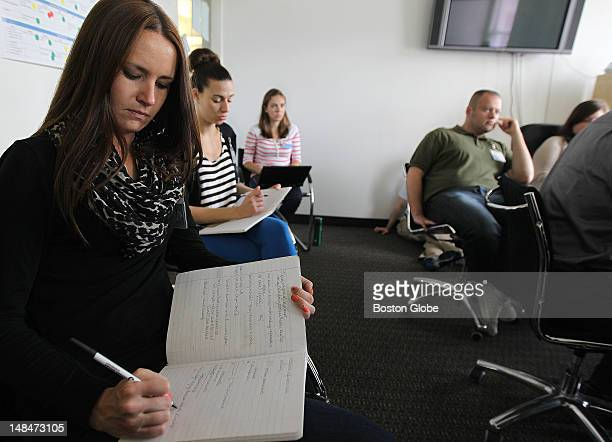 Taking notes at left front to back are Jessica Reinhard graphic designer Ashleigh Kaneski lead UI/UX designer and creative manager and Carlin Reilly...