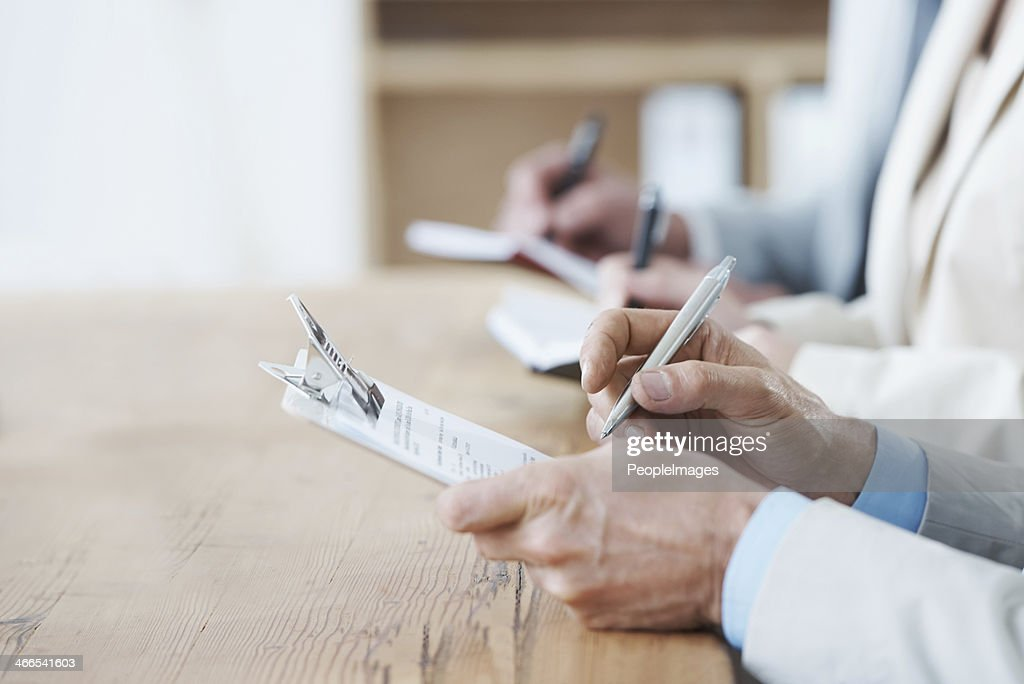 Taking notes at the AGM : Stock Photo