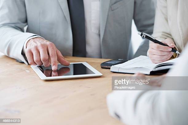 Taking notes on his digital tablet