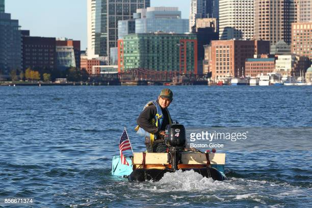 Taking off from Jeffries Yacht Club in East Boston Christian Ilsley pilots his pumpkin boat around Boston Harbor on Oct 1 2017 It was built from his...