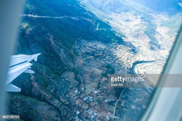 taking off from paro airport, paro, bhutan. - paro stock pictures, royalty-free photos & images