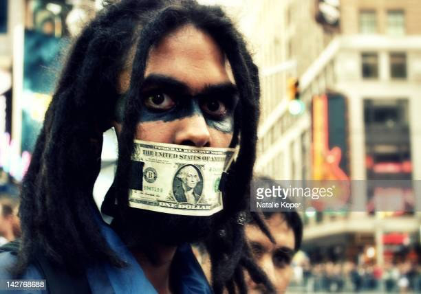 Taking on the banks. Peaceful protesters, a part of the Occupy movement gather in Times Square, NYC.