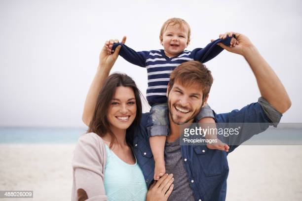 taking our little boy to the beach - family with one child stock pictures, royalty-free photos & images